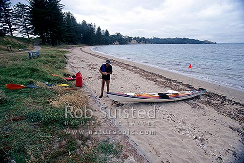 Sea Kayaker on Waihaorangatahi Bay Beach, Motuihe Island, Motuihe Island, Auckland City District, Auckland Region, New Zealand (NZ) stock photo.