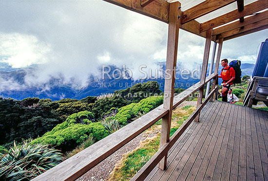 Trampers arriving at Powell tramping hut under near Mount (Mt) Holdsworth, Tararua Ranges, Tararua Forest Park, Carterton District, Wellington Region, New Zealand (NZ) stock photo.