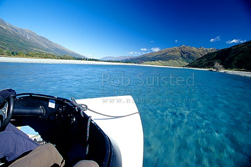Jetboating up the Wilkin River, Makarora, Queenstown Lakes District, Otago Region, New Zealand (NZ) stock photo.