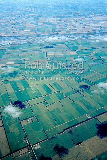 Aerial view of Farmland / agricultural land on the Canterbury Plains. Braided Rakaia River beyond, Darfield, Selwyn District, Canterbury Region, New Zealand (NZ) stock photo.
