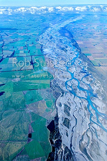 Farmland / agricultural land on the Canterbury Plains and the braided Rakaia River, Darfield, Selwyn District, Canterbury Region, New Zealand (NZ) stock photo.