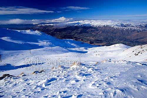 Cardrona Ski field, skiing, skiers and snowboarding and snowboarders, Wanaka, Queenstown Lakes District, Otago Region, New Zealand (NZ) stock photo.