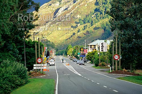 Main street of Murchison township with nice evening lighting, Murchison, Buller District, West Coast Region, New Zealand (NZ) stock photo.