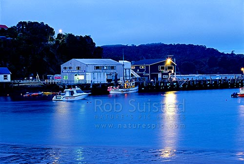 Fisherman's Wharf in Halfmoon Bay (Oban) at twilight, with fishing boats, Halfmoon Bay, Stewart Island District, Southland Region, New Zealand (NZ) stock photo.