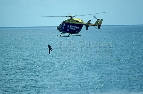 Surf lifesaver jumping from Westpac rescue helicopter ...