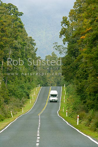 Tourist campervan or motorhome on State Highway 6 near Haast. Vehicle, car on road, Haast, Westland District, West Coast Region, New Zealand (NZ) stock photo.