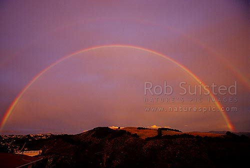 Double rainbows over farmland and suburb, Wellington, Wellington City District, Wellington Region, New Zealand (NZ) stock photo.