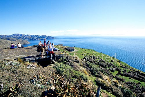 Looking south to Opau Bay, Cook Strait and South Island, from the Makara Gun Emplacements (Fort Opau). Walkers, trampers, picnickers and day walkers, Makara Beach, Wellington City District, Wellington Region, New Zealand (NZ) stock photo.