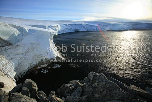 Polar ice cap descending to the sea in George V land, Land's End, Cape Denison, Commonwealth Bay, Commonwealth Bay, George V Land, Antarctica District, Antarctica Region, Antarctica stock photo.