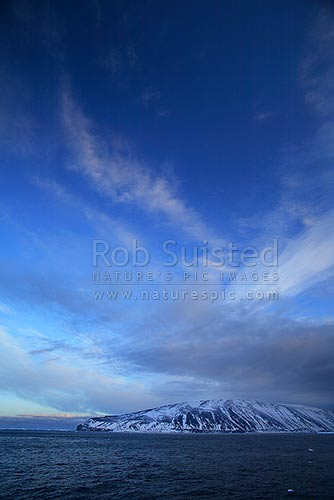 Cloud patterns above Cape Adare and Robertson Bay. Admiralty Mountains distant, Ross Sea. Victoria Land. Cape Adare, Cape Adare, Ross Sea, Antarctica Region, Antarctica stock photo.