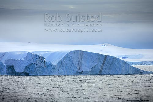 Old grounded and tipped tabular iceberg in Terra Nova Bay, Ross Sea, Antarctica District, Antarctica Region, Antarctica stock photo.