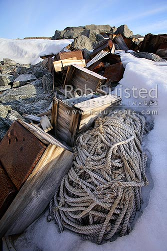 Artefact scatter of store crates and rope behind the Historic 1912-14 Mawson's hut, Cape Denison -'Home of the Blizzard', Commonwealth Bay, George V Land, Antarctica Region, Antarctica stock photo.