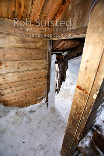 Inside the Historic 1912-14 Mawson's hut, Cape Denison. Entrance via porch into the workshop, Commonwealth Bay, George V Land, Antarctica District, Antarctica Region, Antarctica stock photo.