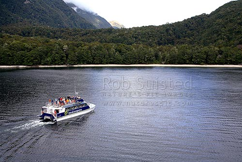 The Real Journeys vessel 'Fiordland Flyer' taking passengers across Lake Manapouri, Fiordland, Southland District, Southland Region, New Zealand (NZ) stock photo.