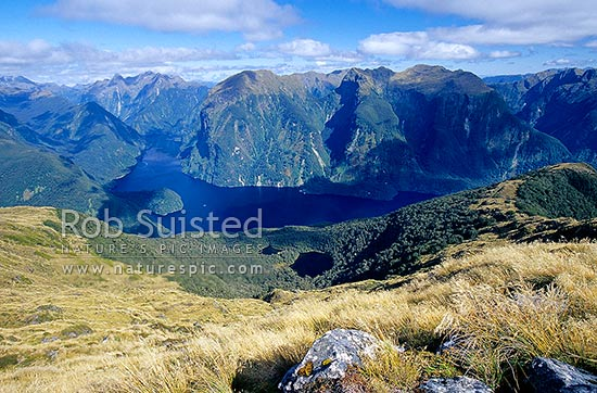 Looking down on Doubtful Sound and Hall Arm (left rear). Commander Peak (1258m) centre. Fiordland National Park, Fiordland National Park, Southland District, Southland Region, New Zealand (NZ) stock photo.