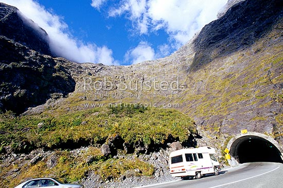 Campervan entering the Milford end of the Homer Tunnel in the head of the Cleddau River Valley. Winter version available: 38245ts00, Fiordland National Park, Southland District, Southland Region, New Zealand (NZ) stock photo.
