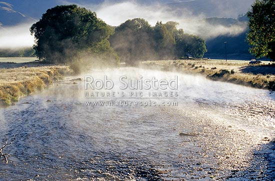 Early morning frosty mist on the Mataura River rapids, Garston, Queenstown Lakes District, Otago Region, New Zealand (NZ) stock photo.