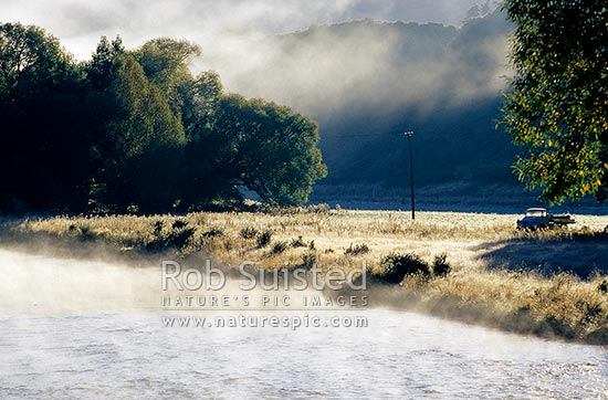 Old truck beside the early morning frost mist on the Mataura River rapids, Garston, Queenstown Lakes District, Otago Region, New Zealand (NZ) stock photo.