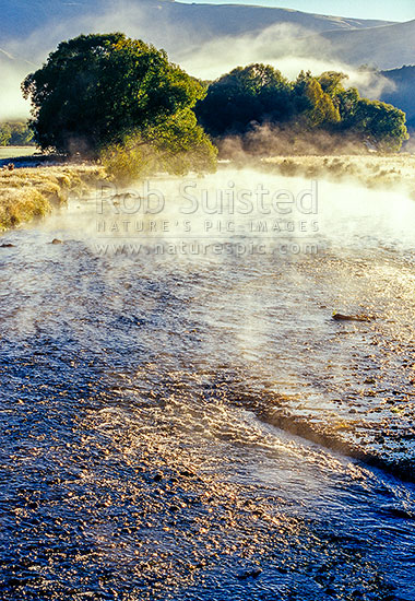 Early morning frost mist on the Mataura River rapids, Garston, Queenstown Lakes District, Otago Region, New Zealand (NZ) stock photo.