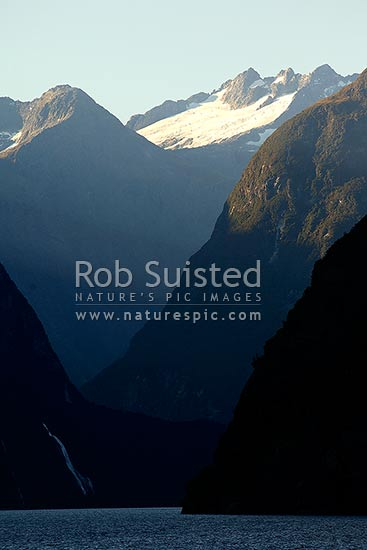 Looking up Milford Sound past Bowen Falls to the Darren Mountains beyond, Fiordland National Park, Southland District, Southland Region, New Zealand (NZ) stock photo.
