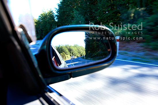 View in the rear view mirror of a car, New Zealand (NZ) stock photo.