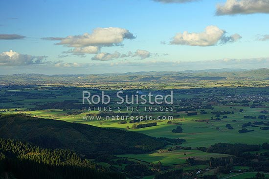 Overlooking rural and farmland on the Wairarapa Plains. Town of Carterton at right, Wairarapa, Carterton District, Wellington Region, New Zealand (NZ) stock photo.