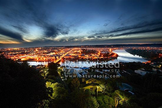 Looking over Wanganui City and Whanganui River at night from Durie Hill, Wanganui City, Wanganui District, Manawatu-Wanganui Region, New Zealand (NZ) stock photo.