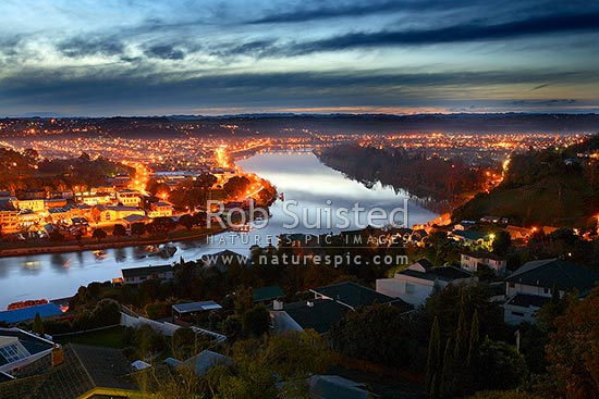 Looking over Wanganui City and up the Whanganui River towards Dublin Street bridge, at night from Durie Hill, Wanganui City, Wanganui District, Manawatu-Wanganui Region, New Zealand (NZ) stock photo.
