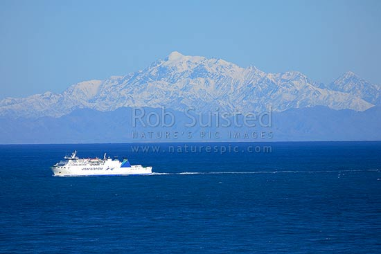 Interislander ferry Aratere crossing Cook Strait with snow covered Kaikoura Ranges behind, Wellington, Wellington City District, Wellington Region, New Zealand (NZ) stock photo.