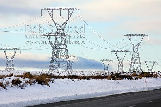 High tension power pylons carrying power north during winter snows on central plateau. Powerlines, Rangipo, Ruapehu District, Manawatu-Wanganui Region, New Zealand (NZ) stock photo.