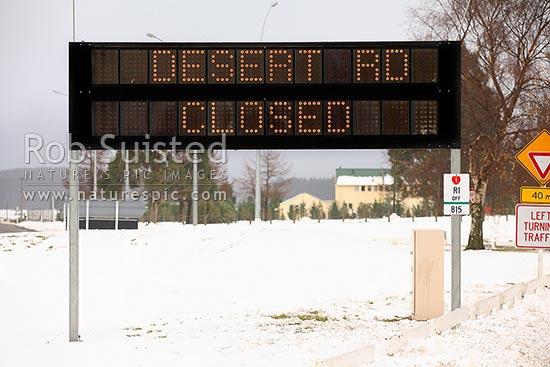 Sign notifying the winter closure of the Desert Road from Rangipo to Waiouru, due to snow and ice, Waiouru, Ruapehu District, Manawatu-Wanganui Region, New Zealand (NZ) stock photo.