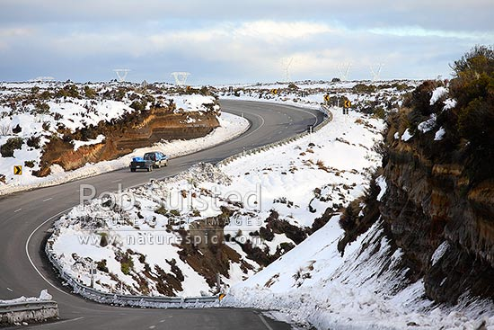 Winter snows and vehicles on the Desert Road (State Highway One SH1), Waiouru, Ruapehu District, Manawatu-Wanganui Region, New Zealand (NZ) stock photo.