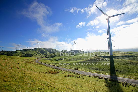 The Road to sustainable energy - Te Apiti wind farm turbines (towers 70m high, 35m blades) in hills above Manawatu Gorge. 90 MW installed capacity, Ashhurst, Manawatu District, Manawatu-Wanganui Region, New Zealand (NZ) stock photo.