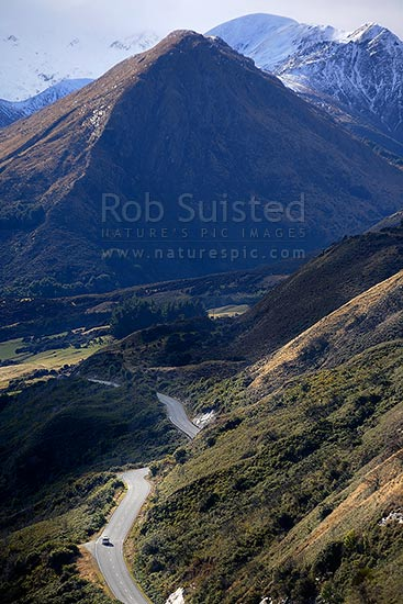 Car on the Queenstown to Glenorchy Road with Lake Wakatipu and Meiklejohns Bay left, Glenorchy, Queenstown Lakes District, Otago Region, New Zealand (NZ) stock photo.