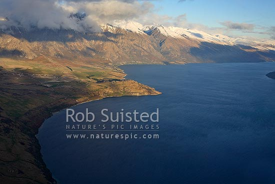 Aerial view over Lake Wakatipu, Jacks Point and the Remarkables Range, Queenstown, Queenstown Lakes District, Otago Region, New Zealand (NZ) stock photo.