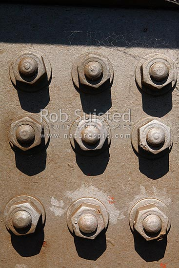 Pattern of large steel bolts and nuts, New Zealand (NZ)  Stock photo