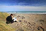 Female student reading on the beach
