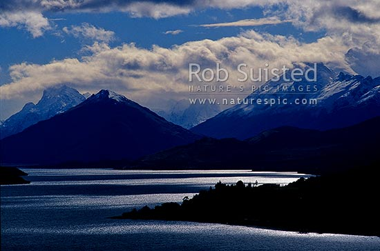 Looking up Lake Wakatipu to Glenorchy and the Rees and Dart Rivers. Pig and Pigeon Islands, Glenorchy, Queenstown Lakes District, Otago Region, New Zealand (NZ) stock photo.