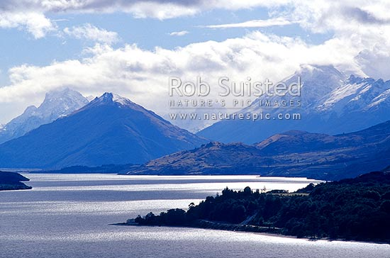Looking up Lake Wakatipu to Glenorchy and the Rees and Dart Rivers. Pig and Pigeon Islands.Snowy mountains in background, Glenorchy, Queenstown Lakes District, Otago Region, New Zealand (NZ) stock photo.
