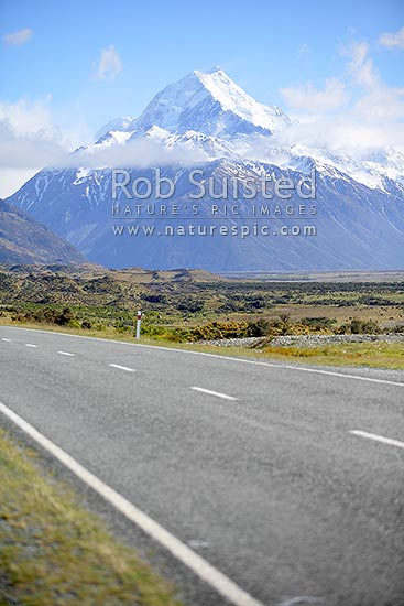 State highway 80 to snowy Mount (Mt) Cook / Aoraki / Aorangi beyond, Aoraki/Mount Cook National Park, MacKenzie District, Canterbury Region, New Zealand (NZ).