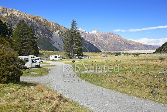 Campervans (Recreational vehicles)and other vehicles in Department of Conservation (DOC) White Horse campground. Cars and tent camping, Aoraki / Mount Cook National Park, MacKenzie District, Canterbury Region, New Zealand (NZ) stock photo.