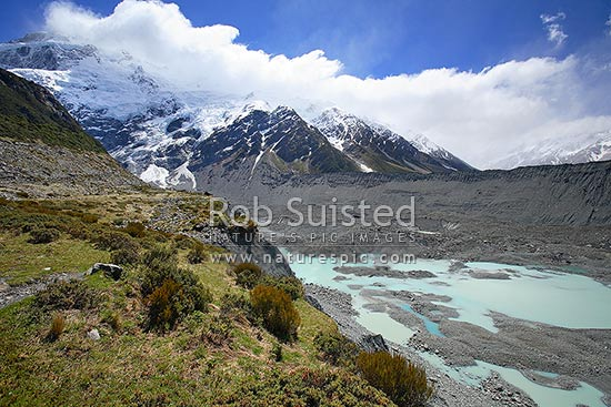 Terminal lake and lateral moraine of the Mueller Glacier, Hooker Valley. Mount (Mt) Sefton (3157masl) and Southern Alps left, Aoraki / Mount Cook National Park, MacKenzie District, Canterbury Region, New Zealand (NZ) stock photo.