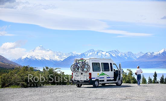 Tourist campervan with mountain bikes stopped near Aoraki / Mount Cook and Lake Pukaki. Southern Alps, Aoraki / Mount Cook National Park, MacKenzie District, Canterbury Region, New Zealand (NZ) stock photo.