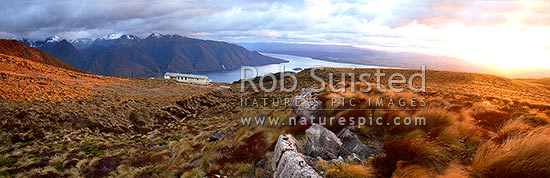Sunrise on Luxmore Hut, first hut on Kepler Track Great Walk. Lake Te Anau and Murchison Mountains beyond. Dawn, Fiordland National Park, Southland District, Southland Region, New Zealand (NZ) stock photo.