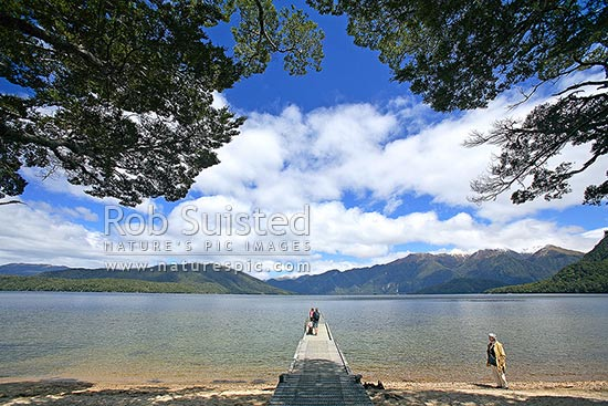 People On The Boat Jetty On The Shore Of Lake Hauroko New