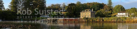 Historic Stone Store (1832) and Mission Station Kemp House (1821-right). Early morning, Kerikeri Inlet Basin. Wide panoramic view, Kerikeri, Far North District, Northland Region, New Zealand (NZ) stock photo.