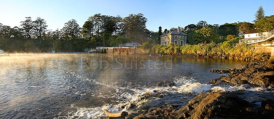Historic Stone Store (1832) and Mission Station Kemp House (1821). Early misty morning, Kerikeri Inlet Basin and River, Kerikeri, Far North District, Northland Region, New Zealand (NZ) stock photo.