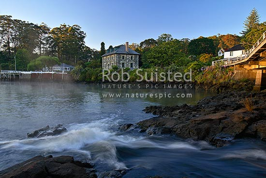 Historic Stone Store (1832) and partial view of Mission Station Kemp House (1821-right). Early morning, Kerikeri Inlet Basin and river, Kerikeri, Far North District, Northland Region, New Zealand (NZ) stock photo.