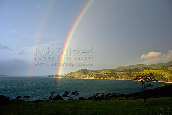 Double rainbow over the Hokianga Harbour and the towns of Omapere and Opononi, Omapere, Hokianga, Far North District, Northland Region, New Zealand (NZ) stock photo.