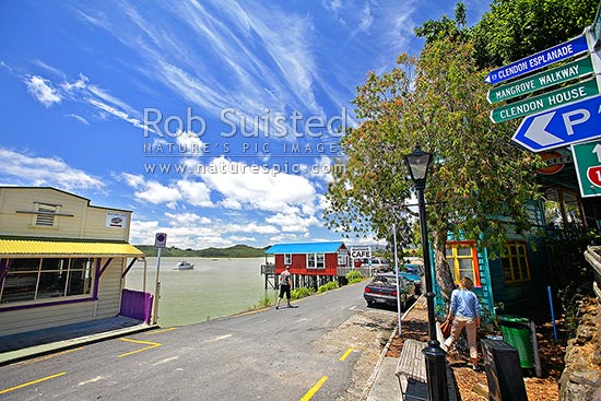 Clendon Esplanade at Rawene. The Boatshed Café and road signs to Clendon House. Historic buildings with Hokianga Harbour beyond, Rawene, Hokianga, Far North District, Northland Region, New Zealand (NZ) stock photo.
